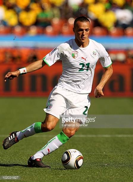 Foued Kadir of Algeria runs with the ball during the 2010 FIFA World Cup South Africa Group C match between Algeria and Slovenia at the Peter Mokaba...