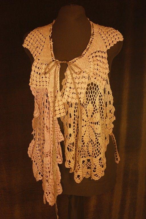 take old doilie's and make something new.....Doilie vintage vest!