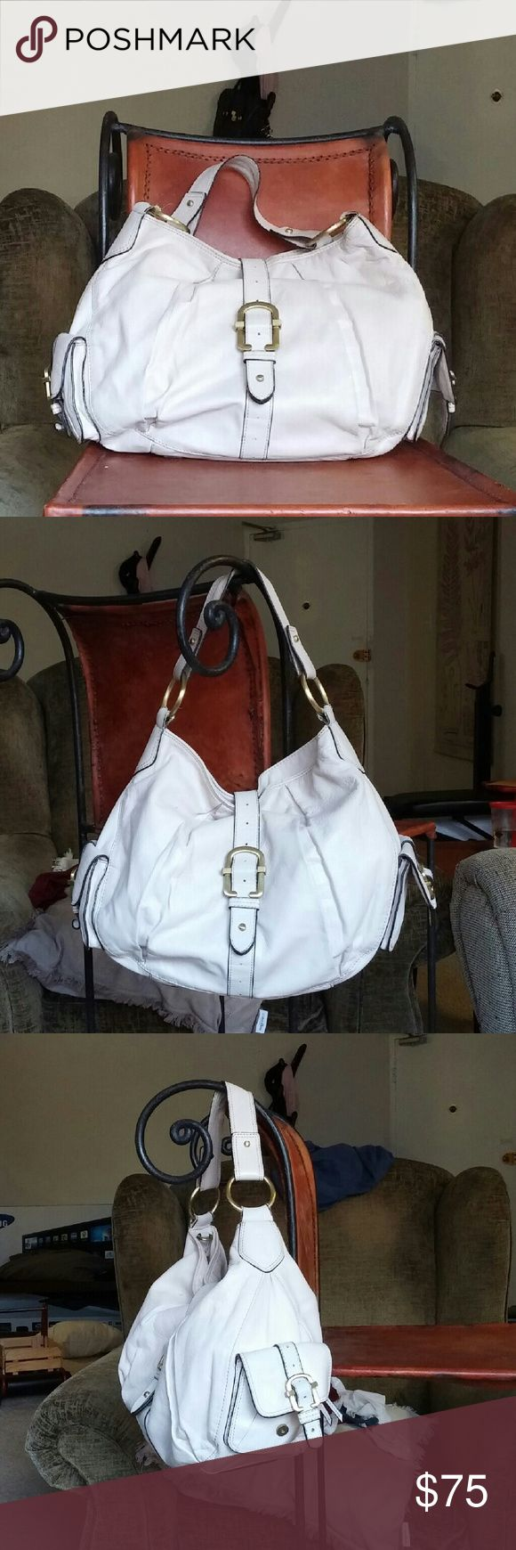 Brio! One of my most favorite bags. Soft leather, 4 large, deep pockets inside the bag. It's a ecru white, so it can be worn all year round. It's sturdy and tough, and can hold a lot. In used condition. Very comfortable tp wear. Comes from smoke free home. Brio! Bags Hobos