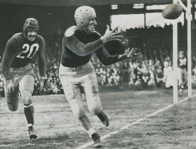 In this 1941 photo earlier in his career, Don Hutson of the Green Bay Packers beats defensive back Bob Seymour of the Washington Redskins to catch a touchdown pass.  Don Hutson, one of the greatest pass catchers in the history of the Green Bay Packers - and perhaps the NFL - scored 31 points (four touchdowns and seven extra points) in a 57-21 rout of the Lions at State Fair Park on Oct 7, 1945. Hutson's 29 points in the second quarter still stands as an NFL record.