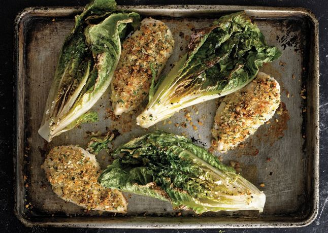 oh my yum! Parmesan Chicken with Caesar Roasted Romaine  The heat chars the edges of the romaine leaves and softens the inner layers.