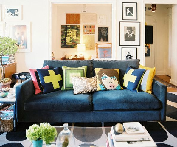 Living Room Midcentury Photo - A blue couch covered in throw pillows atop a patterned rug