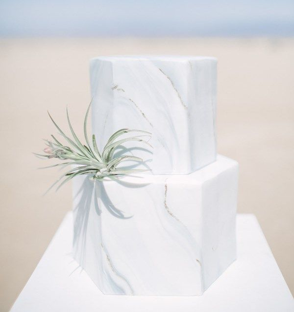 Grey hexagon marble wedding cake - with a sprig of greenery! From Frost It Cakery