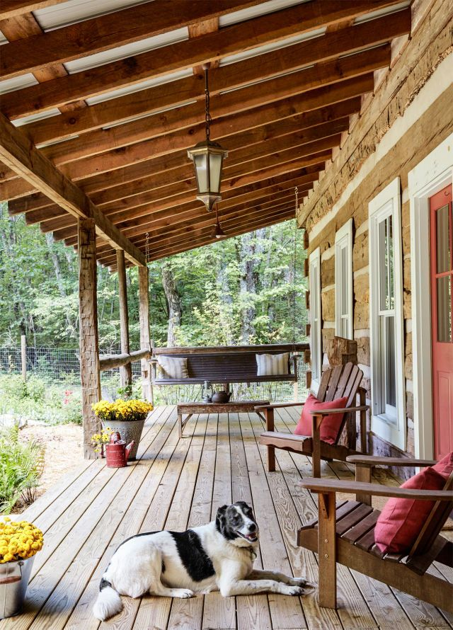 You can still see all of the old holes and nails in the cabin's porch railing, which is made from tobacco barn poles that were originally laid horizontally to hang the tobacco leaves for drying.