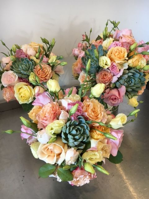Stunning wedding arrangement with flowers from The Loch.