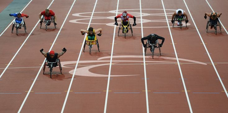 Walid Ktila of Tunisia crosses the line first to win gold in the Men's 200-meter T34 final on day 6 of the London 2012 Paralympic Games at the Olympic Stadium on Sept. 4. (Christopher Lee/Getty Images)