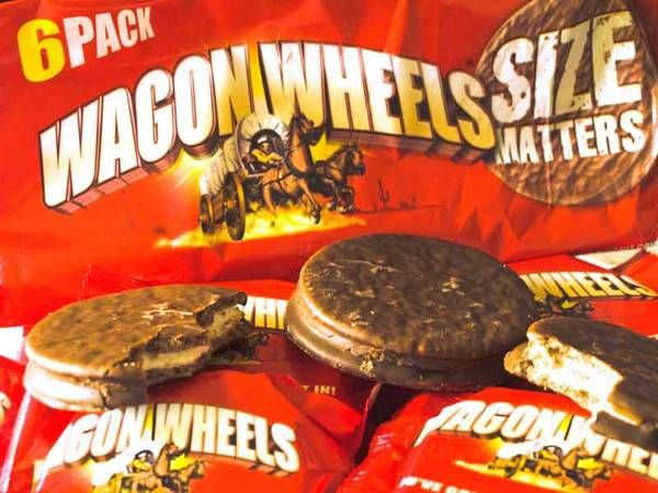 A Wagon Wheel is a biscuit, marshmallow and chocolate disc... sometimes with jam or caramel inside.