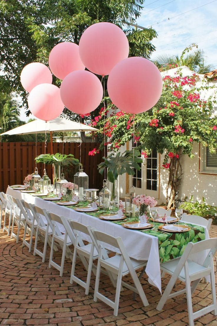 Beautiful tablescape for a pink and green engagement party, bridal shower, or wedding.