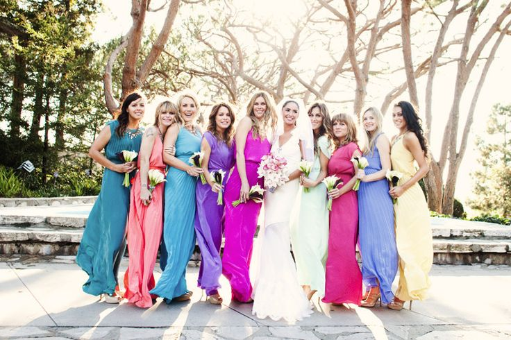 fun multi-colored bridesmaid dresses. I love the yellow, coral and mint ones. Soft and pretty!  photo by Lunaphoto.