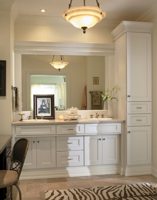 Digital Art Gallery Bath vanity and tall linen closet from Medallion Cabinetry Shown in maple White Icing classic