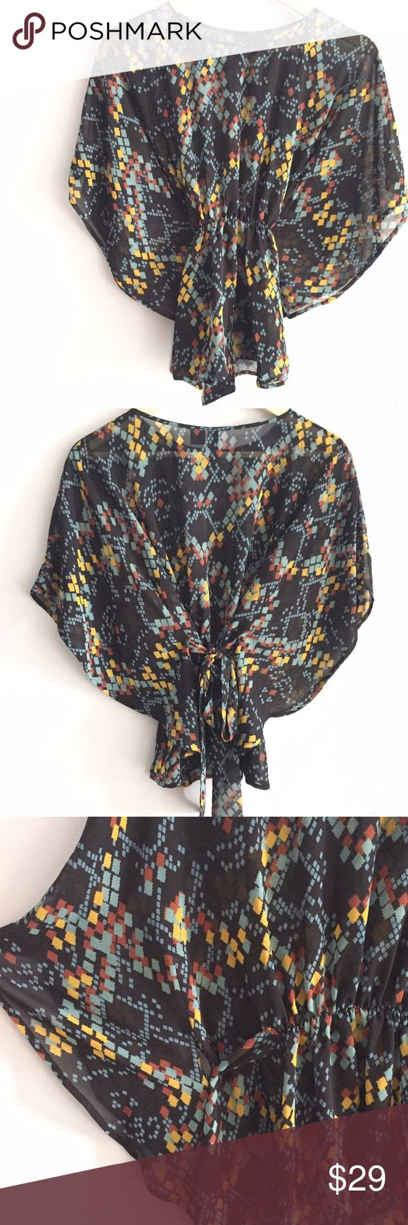 🆕 Listing! Patterned batwing sheer style top Amazing statement top! Gorgeous blend of burgundy, mustard yellow, and ice blue colors. Stretch waist with tie in back. Flattering batwing fit. 100% polyester. Length is 23in. untied and laying flat, from side to side, is 32 3/4in. Very sheer & flowy. Petticoat Alley Tops