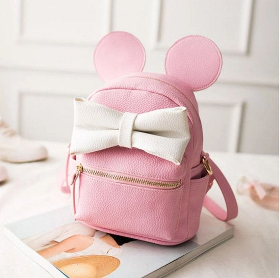 Disney Inspired Minnie Mouse bags are cruelty free, made from high quality faux leather -Comes with 2 adjustable straps -Front zipper pocked and one inside pocket -7 inches across, 9 inches high and 4 inches deep See our other listings for more adorable bags as well as this same bag in black and red
