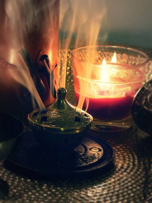 fragrant and spicy tentrils of incense smoke wafting through a cozy bedroom on a rainy day