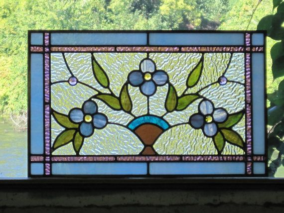 I love this charming, nostalgic piece.  Stained Glass Cottage Style Floral Panel by RenaissanceGlass, $450.00