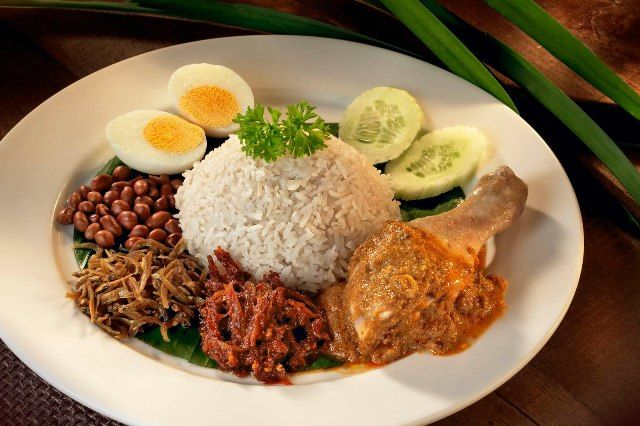 Nasi Lemak or coconut rice is the national food of Malaysia and it is one of the most distinguished dish from Malaysian cuisine.