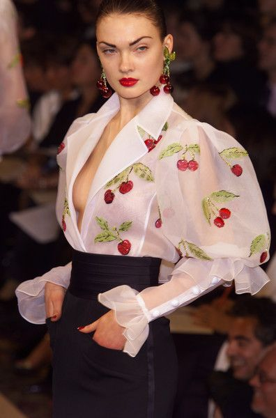 Yves Saint Laurent- attention to détail . Love the shape, not so much the cherries