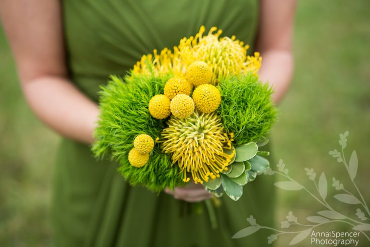 Anna and Spencer Photography, Atlanta Documentary Wedding Photographers. Bridesmaid's Bouquet: Yellow pin cushion protea & Craspedia flowers with Bright green ball dianthus flowers. Green Bridesmaids Dress. Flowers by Making Arrangements of Chattanooga, TN.