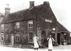 An old photograph showing Huchesson's Saddlery shop in the village of Gosberton Lincolnshire.