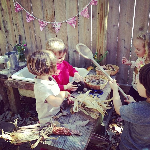 mud kitchen - visit to tip shop - sink, spoons, baskets, vase and how cute to hang bunting!