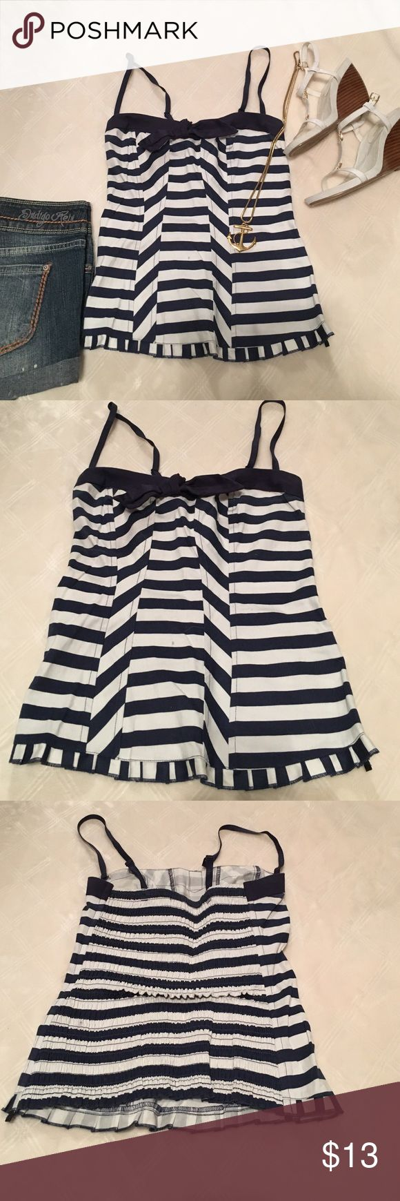 Blue and white nautical top Blue and white nautical top. Straps are adjustable and removable. Bow in the center. Has boning up the sides. Charlotte Russe size small. 98% cotton 2% spandex. Charlotte Russe Tops