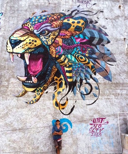 Farid Rueda with his new work in Playa del Carmen, Mexico, 4/15 (LP)
