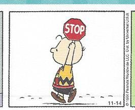 Charlie Brown holding a stop sign while being a school patrol person - image from a 1966 Peanuts comic strip.