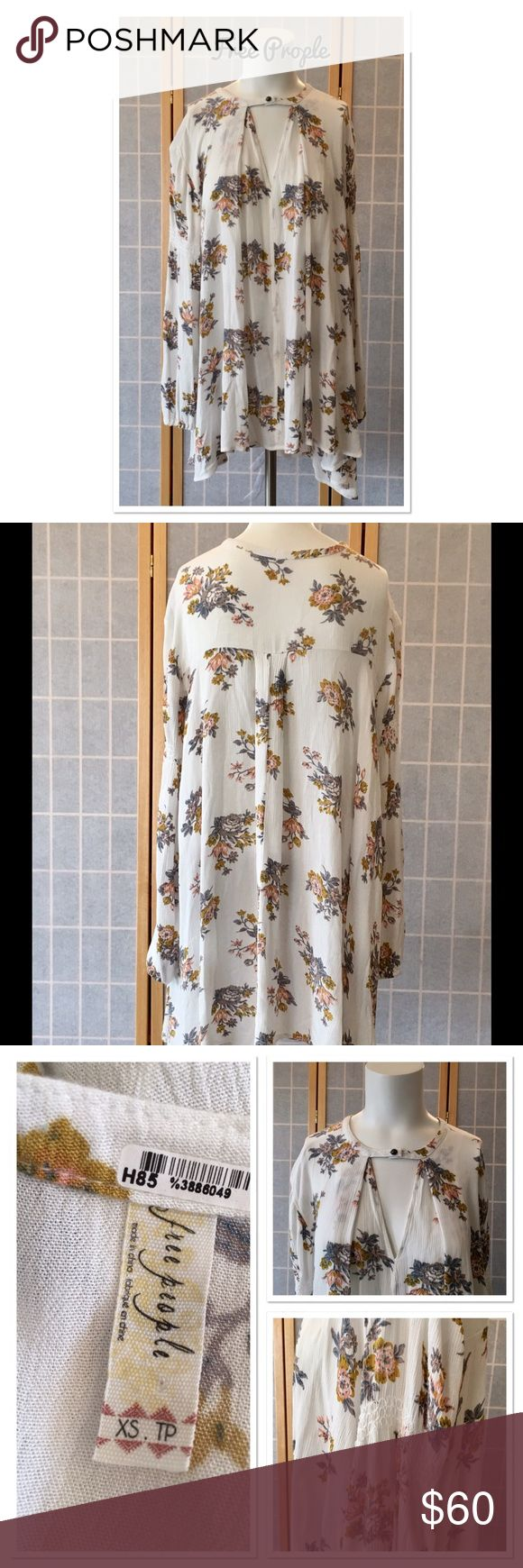 """Free People Retro Print Swing Tunic Keyhole opening at bust. Decorative band on arms and elastic at wrist. Variable length from 30"""" to 34"""". 22.5"""" sleeve length. Excellent condition. Free People Tops Tunics"""