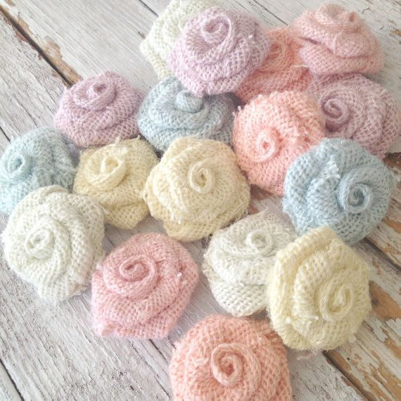 This listing is for 5 sweet burlap flower rosettes in your color choice. They can be used for baby shower decor or for any number of things.