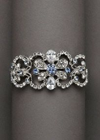 I think this would be perfect to go with my dress! Magnificent cuff bracelet features stunning blue and silver rhinestones.