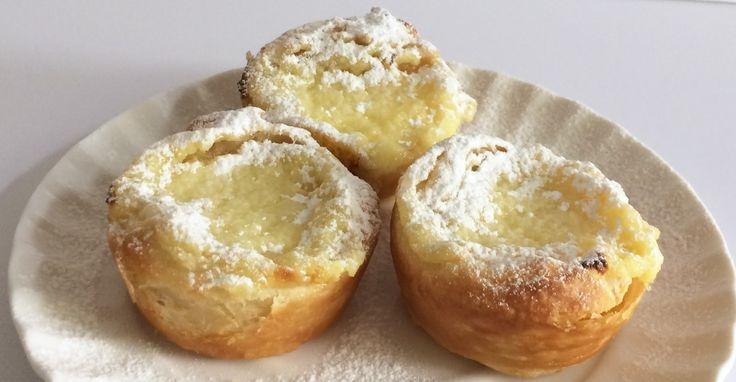 Pasteis de nata, una tartelletta di sfoglia con un cuore di crema cotta tipico del Portogallo. Croccante e morbido, una ricetta di Le Torte di Simona