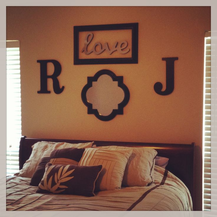 Hobby Lobby letters, mirror love, and open frame...Target decorative mirror...above headboard decor