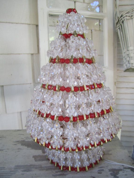 Vintage handmade craft using the ever versatile safety pin! Kitschy Christmas tree made from acrylic clear and red beads all fastened securely -HI white with green