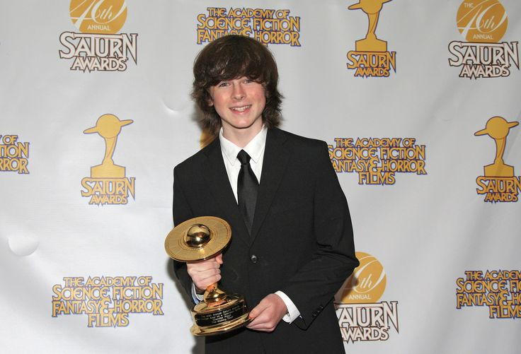 """Chandler Riggs, who plays Carl Grimes on """"The Walking Dead,"""" won the Saturn for best performance by a younger actor in a television series -- one of the show's three wins. (Nina Prommer / European Pressphoto Agency)"""