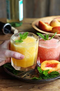 This wine slush is the perfect sip on a hot summer day! Just blend wine and fruit together and freeze into ice cubes, then enjoy a slushie anytime. | LoveGrowsWild.com