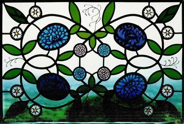 Stained glass with blue flowers by  Janet Hardy