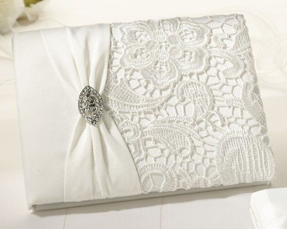 """Vintage Cream Lace Guest Book  This cream vintage and lace guest book is beautifully crafted with an updated antique look.  Guest book is 8.5"""" and holds 55 pages for a total of 990 signatures."""