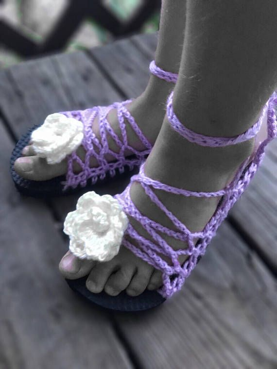 If you are tired of having the same thing as everyone else, these Bohemian style girls shoes are for you.One of a kind, lace up, ankle wrap kids shoes have an attached cream colored flower in t...