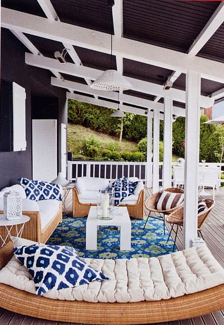 Such a cozy looking outdoor deck/porch. Love the furniture and the ceiling color contrast.