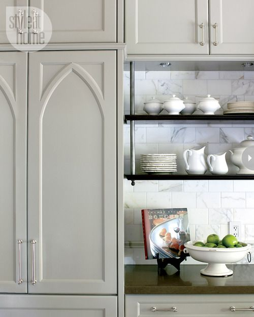 Gothic panel on the fridge, suspended shelves, nickel hardware, marble subway tile. Canadian designer Nam Dang-Mitchell. Via House and Home.