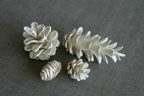 painted white pinecones for table numbers, or maybe for name cards