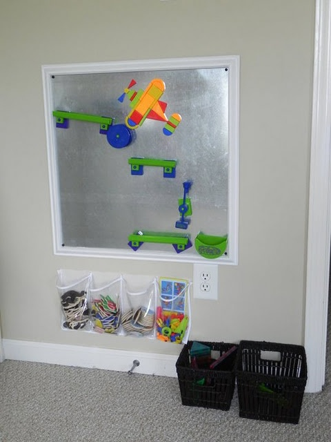 author: This is a magnet board built by my husband - framed sheet metal.  I LOVE this piece.  I used a shoe organizer from target to organize all of the items that are magnetic - as well as two baskets.