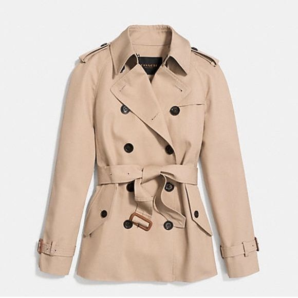 Coach modern short trench coat Perfect condition. Coach trench coat. Worn only a of couple times. Comes with the coach zip up garment bag that I bought it with. Make me an offer! Coach Jackets & Coats Trench Coats
