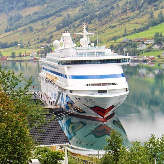 Say good morning to AIDAaura - embedded in the beautiful scenery of Norwegian fjords and mountains ⚓️ #aida #aidaaura #cruises #aidacruises #kreuzfahrt #norway #cruise #fun #adventure #explore #magic #reflection #vacation #photooftheday #loveit #travel #instatravel #followme #like #travelgram #instagood #travelphotos #stunning #view #travel #nature #sunday #morning #sundaymorning #weekend