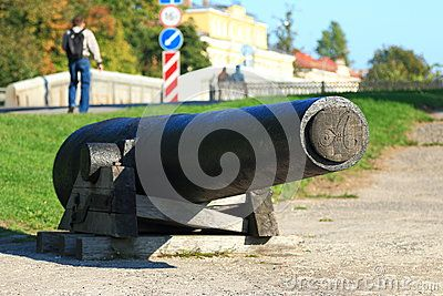 Iron ship's cannon of the 19th century on the waterfront Makarov street in Kronstadt. Kotlin Island. Saint-Petersburg, Russia