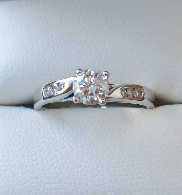 "18ct White Gold Engagement Ring 0.61pt centre diamond G (colour) SI1 (clarity & cut) & side diamonds GSI make total diamond weight 0.75ct Ring comes with Diamond Grading Certificate & Valuation Certificate  Size ""N 1/2"" $ 4,700 www.carellajewellers.com"