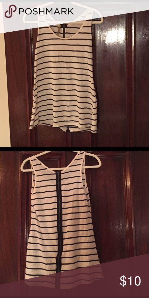 Striped Tank Top White and blue striped tank top is perfect for any summer outfit! Pair with white jeans or jean shorts. It has a zipper that extends the down the whole back for extra detail. It is a medium. Tops Tank Tops