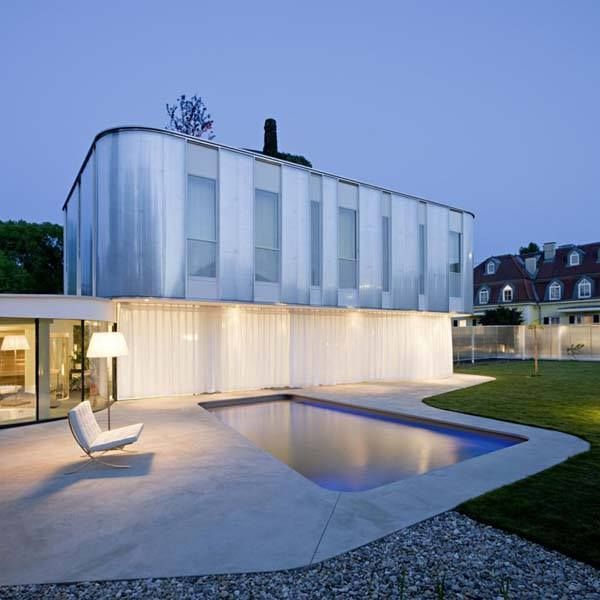 A fascinating residence with displays of curved geometry. Do you like the simplicity?