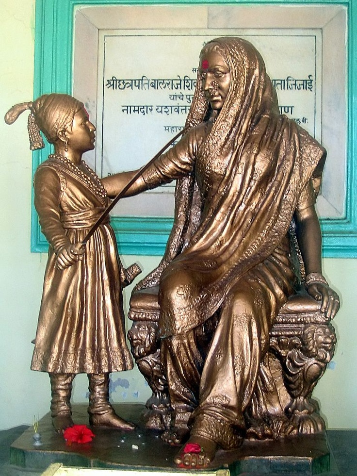 The inspiring statue of young Shivaji on top of Shivneri [ with his traditional sword ], along with Jija Mata.
