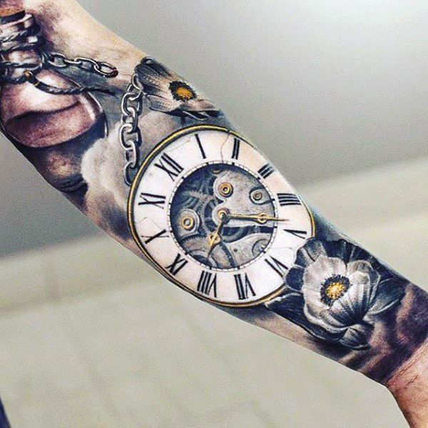 Coloured pocketwatch, chains and flowers tattoo sleeve on lower arm
