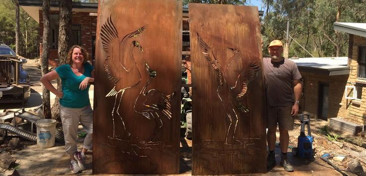 """Dancing Brolgas"" Collaboration between Tim Read from Tread Sculptures and Linda MacAulay.  Plasma cut rusted steel garden screens."